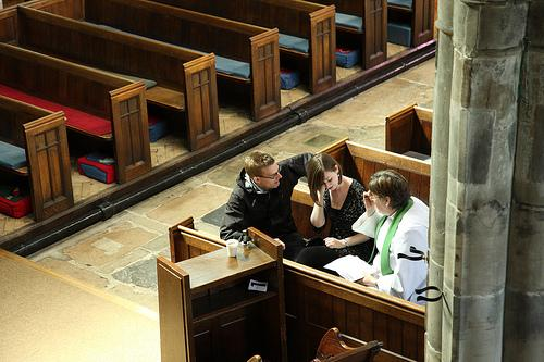 Couple discuss their wedding plans with a priest